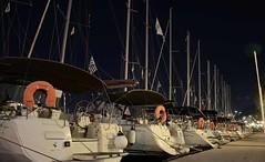 Poros island - sailboats in a row (kutruvis nick) Tags: longexposure night port island greek lights nikon harbour hellas row flags greece nik poles ropes sailboats poros d5100 kutruvis