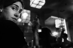 Noir (Vagelis Poulis) Tags: nightphotography light portrait people blackandwhite woman monochrome fashion bar night lowlight noir low streetphotography cinematic filmnoir highiso nightmood womaninblack womanwithcigarette womanportrait iso12800 artlibres womaninbar