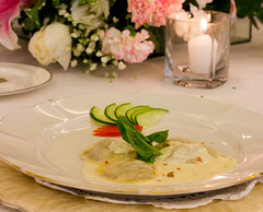 Ravioli of Duck and Duck Liver with Garlic Cream Sauce Drizzled with White Truffle Oil (WOW Philippines Travel Agency) Tags: wedding bride groom flowers roses bouquet food weddingfood cake philippines filet mignon bearnaise sauce ravioli duck liver smoked salmon parmesan cutting display pink icing table party setup rings beautiful cream artichoke soup canonigo mango balls