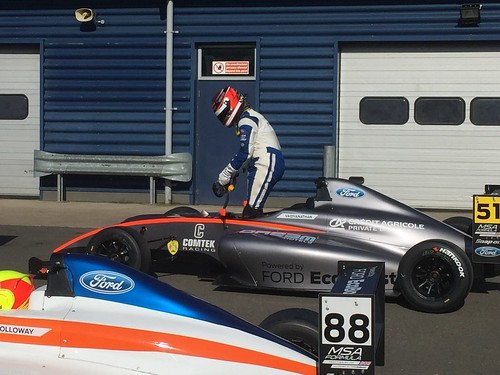 Ameya Vaidyanathan gets out of his car after the MSA Formula race at Rockingham