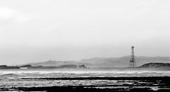 A Stormy Shore (Alex Wrigley) Tags: blackandwhite beach windy stormy shore coastline radiotower roughsea landscapephotography coastalphotography lakedistrictphotography cumbriaphotography alexwrigley alexwrigleyphotography