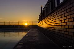 Pool sunrise (grahamvphoto) Tags: city sun brick texture pool wall sunrise fence golden glow