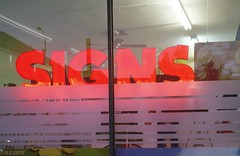 Signs (ADMurr) Tags: light red signs night rollei zeiss la kodak pico storefront mf planar ektar