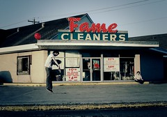 Balloon Boy Floats Away (DarlingJack) Tags: boy red rabbit marquee flying sitting avatar cleaners balloon fame surreal floating levitation dry laundry thinking signage curb angsty introspective