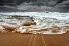 Storm Wash (Crouchy69) Tags: ocean sea sky seascape storm motion beach water clouds sunrise landscape flow dawn coast sand rocks waves sydney australia turimetta