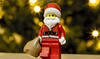 Santa delivering presents (jezbags) Tags: lego macrolego macrophotography macro santa presents lights green red canon60d canon 60d 100mm closeup beard hat xmas christmas sack