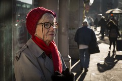 Red Or Dead (Leanne Boulton) Tags: people urban street candid portrait portraiture streetphotography candidstreetphotography candidportrait streetportrait streetlife woman old aged elderly female face facial expression look emotion feeling mood atmosphere backlit backlighting rim bright red hat scarf wool glasses winter tone texture detail depthoffield bokeh naturallight outdoor light shade shadow sunlight city scene human life living humanity society culture canon 5d 5dmarkiii 70mm ef2470mmf28liiusm character color colour glasgow scotland uk