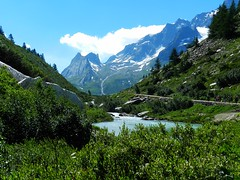 Courmayeur in green (moniq84) Tags: courma courmayeur green trees grass lake river sky cloud clouds blue mountain valle daosta aosta summer landscape landscapes nature val veny people walking