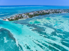 Aerial view of the blue waters of the Caribbean Sea near Caye Caulker, Belize