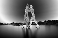 Molecule Man - Jonathan Borofsky (Christian_from_Berlin) Tags: longexposure vacation sky blackandwhite holiday man black berlin art scale water monochrome clouds river germany deutschland lights mono europe artist darkness hole body sony hauptstadt award skulptur monochromatic minimal filter le mann loch melancholy schwarzweiss spree tones kontrast weiss sculptures schwarz treptow dunkel aluminium leben mnner molecule abstrakt waterreflection jonathanborofsky melancholic kunstwerk compactcamera langzeitbelichtung moleculemen knstler carlzeiss ndfilter stativ moleculeman krper treptowers melancholie einfarbig daytimelongexposure bundeshauptstadt neutraldensityfilter 100faves spreeriver molekl graufilter berlinart sonyrx100 infiniteexposure moleculemanjonathanborofsky
