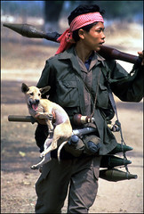 "A CPAF soldier walks along the road with his ""pet,"" Siem Riep, Cambodia"