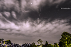 Orion constellation and geminid meteor under heavy Cloud cover over Sydney