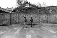 Ancient (kiatography1) Tags: china street travel houses 2 two people urban blackandwhite white house snow black streets wall landscapes alley asia sony traditional bricks olympus using human walkway subject passage residential jiuzhaigou f4 bnw handphone omd texting 1635 em10 a7r kuanzhaialley 1635f4 kuanzhai