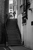 Passing by (Mister Rad) Tags: nikond600 nikon50mmf14g london blackandwhite stairs people citystreets