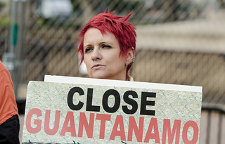 Silke Tudor Holds a Sign at an Anti-Torture Demonstration Outside the White House