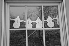 Lined up (brucetopher) Tags: snowmen paper project cutout line paperdoll window looking watching lookingout out outside snow snowfall winter black white blackandwhite bw blackwhite monochrome tone tones pane windowpane divider divide snowman