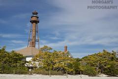 Lighthouse (morgan.roberts1999) Tags: lighthouse trees sky ocean beach clouds blue