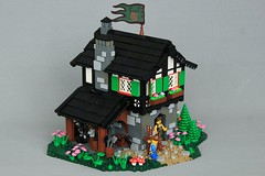 Hardwin's Smithy (jsnyder002) Tags: lego creation medieval castle blacksmith smithy house tudor classic roof forge interior wall texture landscape irregular base design technique chimney flag vine chair fire
