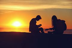 Musicians at Sunset (Image Catalog) Tags: ocean friends sunset sky musician music orange sun sunlight love silhouette yellow seaside couple friendship ukulele guitar outdoor horizon livemusic romance barefoot publicdomain bandmembers