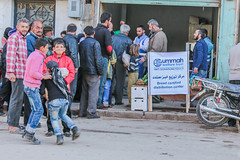 Displaced residents queue for free bread in Ariha, Idlib (Ummah Welfare Trust) Tags: poverty children war islam aid hunger arab syria humanitarian إدلب، سوريا