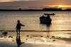 EL NIÑO Y LA MAR (bacasr) Tags: castillo castle mar contraluz andalucía water reflections bote puestadesol sea agua beach spain niño lacaleta backlight reflejos sunset boat child cádiz españa playa