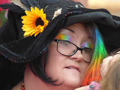 The Rainbow Fairy (Steve Taylor (Photography)) Tags: fairy picnic rainbow facepaint sunflower hat sewing glasses shell wig feather colourful fun lady woman newzealand nz southisland canterbury christchurch newbrighton flower necklace