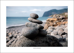 Size comparison (G. Postlethwaite esq.) Tags: atlanticocean christmas madeira portugal cliffs coast pebbles photoborder praia shore sky waves fujix100t