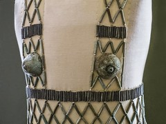 Closeup of Qao bead net dress Faience, blue and black cylinder beads, 2 breast caps and 2 strings of Mitra beads. 5th Dynasty Old Kingdom. From burial 978 at Qau (Tjebu), Egypt. (mharrsch) Tags: dress fashion apparel bead beadnet ancient egypt faience 5thdynasty oldkingdom qau tjebu petriemuseum london england mharrsch