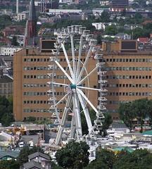 Aerial view of ferris wheel in Hamburg (phototouring) Tags: city germany deutschland town europe hamburg cities fair aerial fromabove german ferriswheel amusementpark towns fromtheair birdseye aerials funpark pariserhjul hamburgerdom