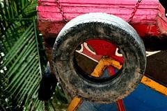 peeking (Farl) Tags: travel heritage colors river boat chains eyes paint delta tire palm vietnam peek tradition mekong portals