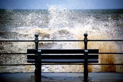 Splash (m4r00n3d) Tags: uk sea england topf25 water colors bench topf50 nikon topf75 tide nikond50 moo splash nikkor blackpool scoreme40 judgementday52