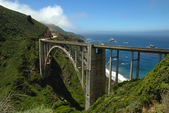 Bixby Bridge, Pacific Coast Hwy, California (Thad Roan - Bridgepix) Tags: ocean california bridge sea mountains beach water clouds creek concrete coast photo arch bridges bigsur arches bluesky historic hills highway1 pacificocean carmel wikipedia montereycounty rainbowbridge bixbybridge bridging bixbycreek bixbycreekbridge 200606 skyarchitecture bridgepixing bridgepix abigfave