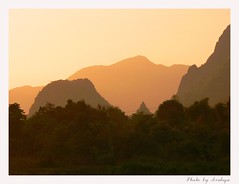 An Evening Dream (Araleya) Tags: travel light sunset mountain art nature beautiful landscape fz20 interestingness twilight colorful peace artistic vivid panasonic serene colourful laos vangvieng interestingness56 artisitc artcore romanticism iloveit interstingness araleya interestingness478 i500 bluelist songriver artbynature angkorsingle