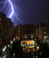 Lightning Strikes (swamysk) Tags: light cloud india white storm night clouds evening bright swimmingpool monsoon bombay lightning mumbai maharastra thunder malad blockofflats swamysk