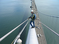 tight rope walker (unaesthetic) Tags: sanfrancisco bridge urban bay climb 2006 climbing cables area heights exploration chrisbrennan suspention urbanex