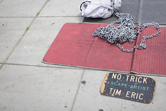 no trick (Orrin) Tags: california street venice sign chains lenstagged escape magic chain sidewalk mat boardwalk venicebeach trick busker performer canonef2470mmf28lusm 2470l props prop magician escaped escapeartist added2hcsp magnumesque notrick timeric