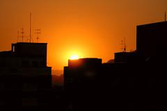 Santos Setting (Daniel Pascoal) Tags: sunset pordosol orange sun sol public yellow buildings nikon l1 laranja amarelo santos prdios danielpg