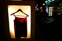Lonely clothes (Solar ikon) Tags: night store taiwan natura 2006 daily taipei iso1600 nightstreet     classica