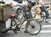 Life can be hard (Alex Vinter) Tags: life china street hot bike tag3 tag2 tag1 shanghai hard lookatme melons humid kiss2 kiss3 kiss1 kiss4 kiss5 festivalparis festivallondon