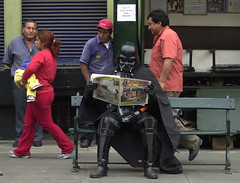Darth Vader reads a newspaper
