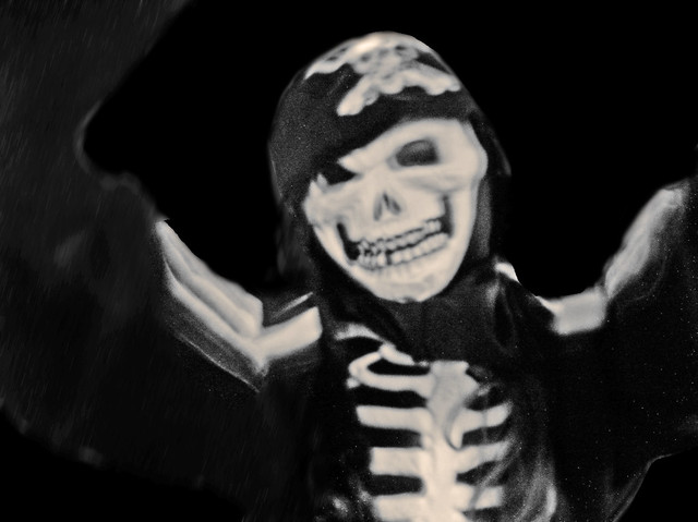The child experiments with being a pirate skeleton