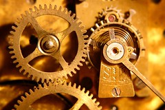 Clock Work (Neville_S) Tags: red macro clock beautiful gold interestingness spring warm glow dof explore canon350d tick gears 250v10f nevillesukhiaphotography