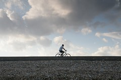 A Man Passes on a Bicycle - by Aeioux
