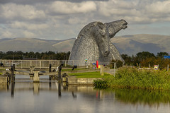 Kelpies (Kev Gregory (General)) Tags: kelpies 30 metre high horse head sculpture standing next new extension forth clyde canal river carron the helix parkland project built connect communities falkirk council area scotland designed sculptor andy scott form gateway monument powered heritage turning pool navigation between east west scottish canals name reflected mythological transforming beasts possessing strength endurance 10 horses heavy industry economy pulling wagons ploughs barges coalships shaped geographical kev gregory canon 7d
