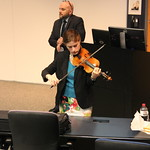 Professor playing violin.