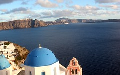 Iconic view of Santorini (Nagarjun) Tags: blue sunset sun white church island volcano evening europe glow santorini caldera oia cyclades mediterranian firostefani aegeansea
