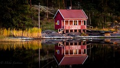 Reflection (Mika Laitinen) Tags: red sea house reflection water canon finland bay calm baltic 7d vuosaari uutela ncg helasinki