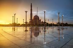 Putra Mosque (Landscape Junkie) Tags: sunset rain reflections malaysia putrajaya goldenhour cpl sigma1020mm putramosque masjidputra leefilters nikond90 leecpl landscapejunkie muhamadfaisalibrahim