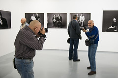 Target Locked! (Igor Voller) Tags: camera white man men smile face smiling wall happy photography hall gallery foto leute photographer faces photos russia bokeh moscow exhibition depthoffield shooting halle  mensch     gallerie          fotoapparat