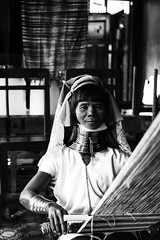 Long neck woman weaving silk (Tom Anirae) Tags: myanmar burma birmanie inle lake nyaung shwe shan state asia south east travel voyage asie asian traveller world worldwide ngc national geographic nationalgeographic black white blackandwhite noir et blanc noiretblanc bw monochrome contrast nikon 70210 nikkor 70mm f4 sharp sharpness people long neck woman women working hand handcraft handycraft handmane old beauty costume blackandwhitephotos